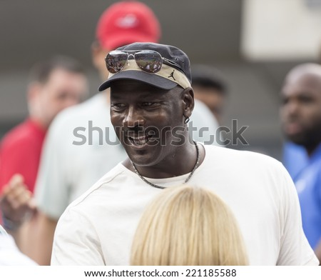 NEW YORK, NY - SEPTEMBER 6, 2014: Michael Jordan attends semifinal match Marin Cilic of Croatia & Roger Federer of Switzerland at US Open championship in Flushing Meadows USTA Tennis Center - stock photo