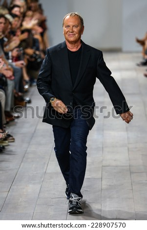 NEW YORK, NY - SEPTEMBER 10: Michael Kors greets the audience after presenting his Michael Kors Spring 2015 Collection during MBFW Spring 2015 at Spring Studios on September 10, 2014 in NYC.