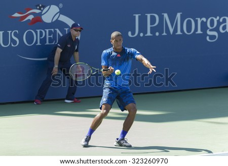 New York, NY - September 7, 2015: Michael Mmoh of USA returns ball during 1st round junior boys match against Evan Furness of France at US Open Championship - stock photo