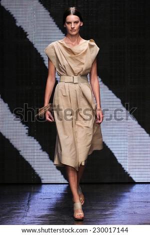 NEW YORK, NY - SEPTEMBER 08: Model Amanda Murphy walk the runway at Donna Karan New York during MBFW Spring 2015 at 547 West 26th Street on September 8, 2014 in NYC - stock photo