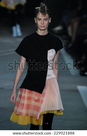 NEW YORK, NY - SEPTEMBER 09: Model Dasha Denisenko walks the runway at the Marc By Marc Jacobs fashion show during Mercedes-Benz Fashion Week Spring 2015 at Pier 94 on September 9, 2014 in NYC. - stock photo