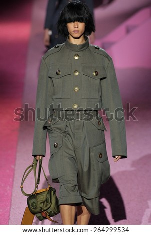 NEW YORK, NY - SEPTEMBER 11: Model Hind Sahli walk the runway at Marc Jacobs during Mercedes-Benz Fashion Week Spring 2015 at Seventh Regiment Armory on September 11, 2014 in NYC. - stock photo