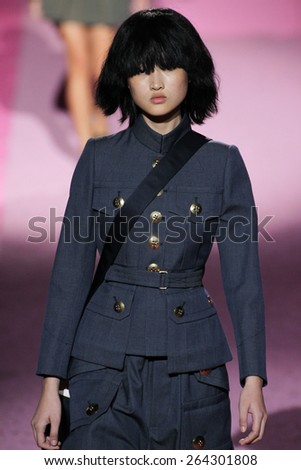 NEW YORK, NY - SEPTEMBER 11: Model Jing Wen walk the runway at Marc Jacobs during Mercedes-Benz Fashion Week Spring 2015 at Seventh Regiment Armory on September 11, 2014 in NYC. - stock photo