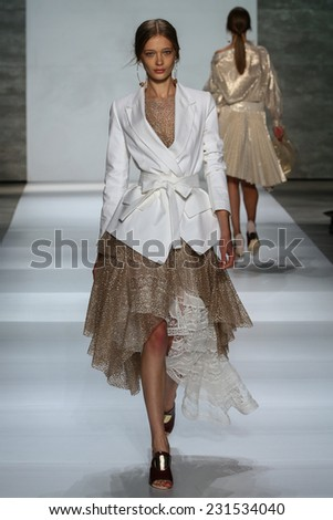 NEW YORK, NY - SEPTEMBER 05: Model Tanya Katysheva walk the runway at the Zimmermann fashion show during MBFW Spring 2015 at Lincoln Center on September 5, 2014 in NYC - stock photo