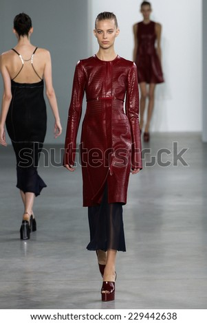 NEW YORK, NY - SEPTEMBER 11: Model walk the runway at the Calvin Klein Collection fashion show during MBFW Spring 2015 at Spring Studios on September 11, 2014 in NYC. - stock photo
