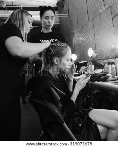 New York, NY - September 10, 2015: ModelMargarita Pugovka prepares backstage for the Desigual fashion show during the Spring Summer 2016 New York Fashion Week at The Arc - Skylight Moynihan Station