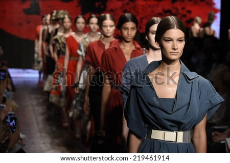 NEW YORK, NY - SEPTEMBER 08: Models walk the runway finale at Donna Karan New York during Mercedes-Benz Fashion Week Spring 2015 on September 8, 2014 in New York City. - stock photo