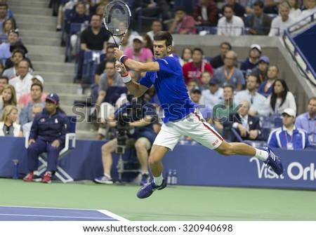 New York, NY - September 13, 2015: Novak Djokovic of Serbia returns ball against Roger Federer of Switzerland during final of US Open Championship at Ash stadium - stock photo