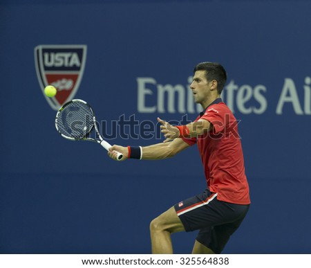 New York, NY - September 2, 2015: Novak Djokovic of Serbia returns ball during 2nd round match against Andreas Haider-Maurer of Austria at US Open Championship  - stock photo