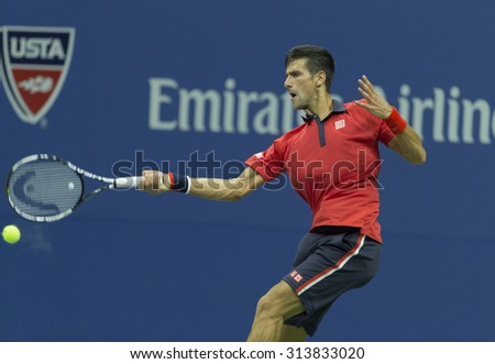 New York, NY - September 6, 2015: Novak Djokovic of Serbia returns ball during 4th round against Roberto Bautista Agut of Spain at US Open Championship - stock photo