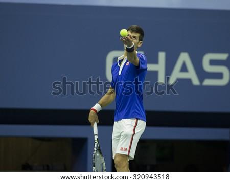 New York, NY - September 13, 2015: Novak Djokovic of Serbia serves against Roger Federer of Switzerland during final of US Open Championship at Ash stadium - stock photo
