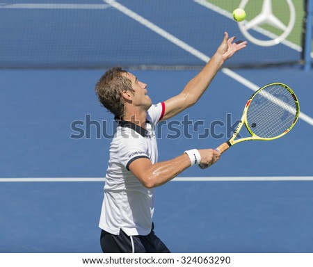 New York, NY - September 5, 2015: Richard Gasquet of France serves during 3rd round match against Bernard Tomic of Australia at US Open Championship