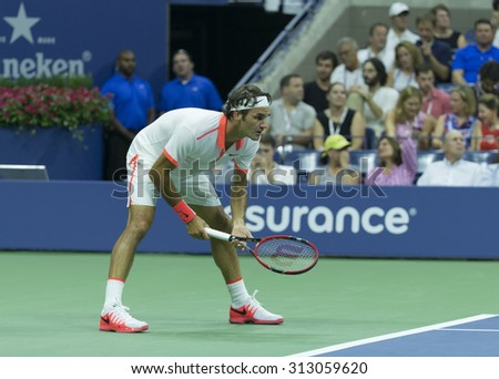 New York, NY - September 3, 2015: Roger Federer of Switzerland prepares during 2nd round match against Steve Darcis of Belgium at US Open championship - stock photo