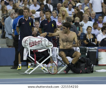 NEW YORK, NY - SEPTEMBER 4, 2014: Roger Federer of Switzerland relaxes during changeover at  quarterfinal match against Gael Monfils of France at US Open championship in Flushing Meadows USTA Center - stock photo