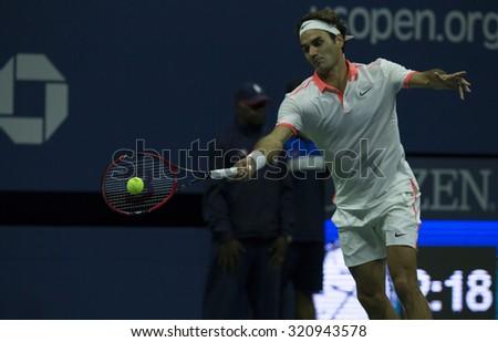 New York, NY - September 13, 2015: Roger Federer of Switzerland returns ball against Novak Djokovic of Serbia during final of US Open Championship at Ash stadium - stock photo