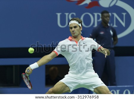 New York, NY - September 3, 2015: Roger Federer of Switzerland returns ball during 2nd round match against Steve Darcis of Belgium at US Open championship