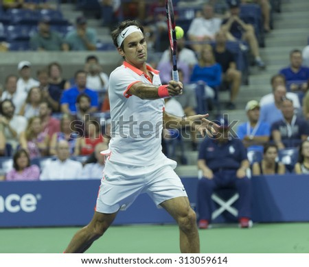 New York, NY - September 3, 2015: Roger Federer of Switzerland returns ball during 2nd round match against Steve Darcis of Belgium at US Open championship - stock photo