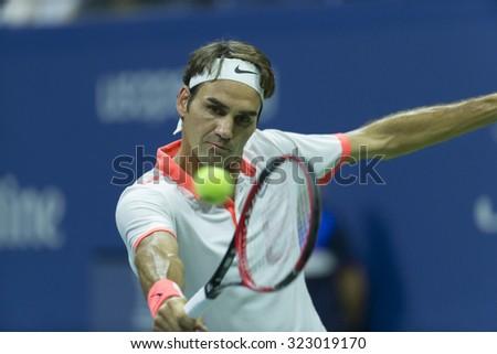 New York, NY - September 3, 2015: Roger Federer of Switzerland returns ball during 2nd round match against Steve Darcis of Belgium at US Open championship - stock photo