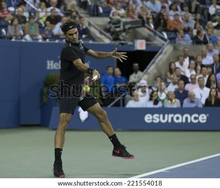 NEW YORK, NY - SEPTEMBER 4, 2014: Roger Federer of Switzerland returns ball during quarterfinal match against Gael Monfils of France at US Open championship in Flushing Meadows USTA Tennis Center - stock photo