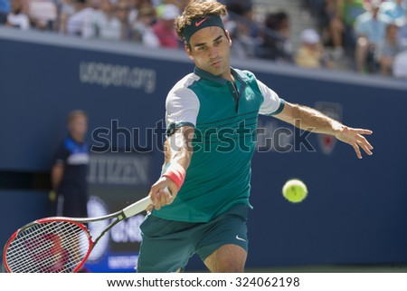 New York, NY - September 5, 2015: Roger Federer of Switzerland returns ball during 3rd round match against Philipp Kohlschrieber of Germany at US Open Championship