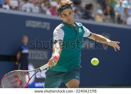 New York, NY - September 5, 2015: Roger Federer of Switzerland returns ball during 3rd round match against Philipp Kohlschrieber of Germany at US Open Championship - stock photo