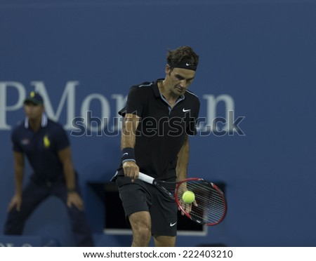NEW YORK, NY - SEPTEMBER 2, 2014: Roger Federer of Switzerland returns ball during 4th round match against Bautista Agut of Spain at US Open in Flushing Meadows USTA Tennis Center - stock photo