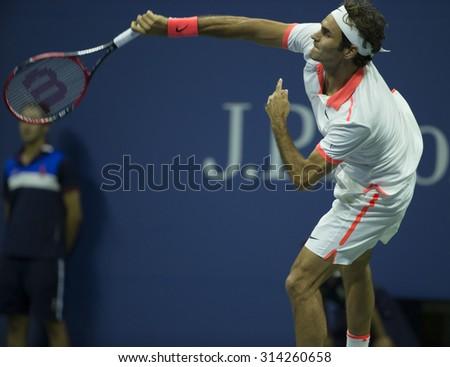 New York, NY - September 7, 2015: Roger Federer of Switzerland returns ball during 4th round match against  John Isner of USA at US Open Championship - stock photo
