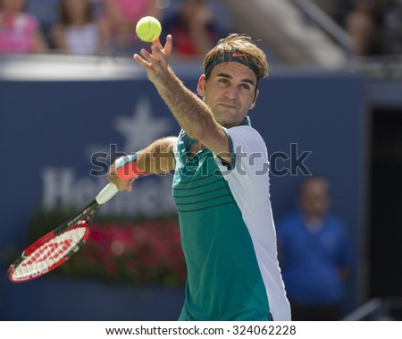 New York, NY - September 5, 2015: Roger Federer of Switzerland serves during 3rd round match against Philipp Kohlschrieber of Germany at US Open Championship - stock photo
