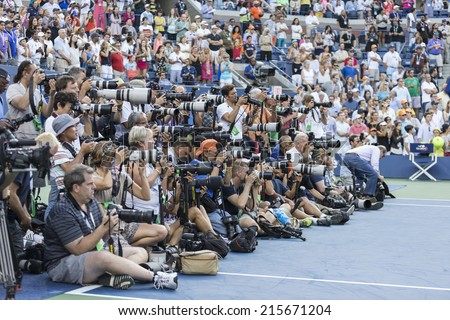 NEW YORK, NY - SEPTEMBER 7, 2014: Rows of photographers covering Serena WIlliams of USA and Caroline Wozniacki of Denmark trophy presentation at US Open championship in Flushing Meadows USTA Center - stock photo