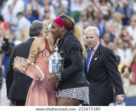NEW YORK, NY - SEPTEMBER 7, 2014: Serena WIlliams of USA embraces Caroline Wozniacki of Denmark after winning final match against her at US Open championship in Flushing Meadows USTA Tennis Center - stock photo