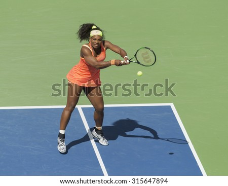 New York, NY - September 11, 2015: Serena Williams of USA returns ball during semifinal match against Roberta Vinci of Italy at US Open Championship