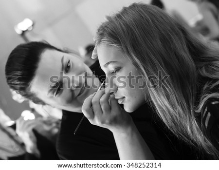 New York, NY - September 12, 2015: Sija Titko prepares backstage for the Monique Lhuillier Spring 2016 fashion show during New York Fashion Week at The Arc - Skylight Moynihan Station - stock photo