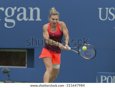 New York, NY - September 11, 2015: Simona Halep of Romania returns ball during semifinal match against Flavia Pennetta of Italy at US Open Championship - stock photo