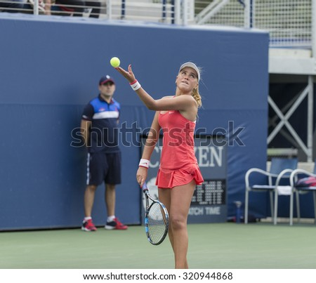 New York, NY - September 13, 2015: Sofia Kenin of USA serves against Dalma Galfi of Hungary during final girls junior US Open Championship
