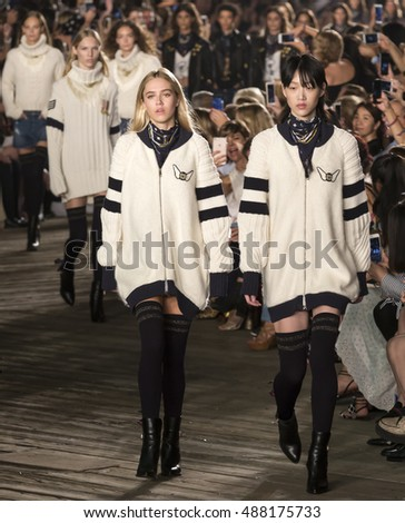 NEW YORK, NY - SEPTEMBER 09, 2016: Sora Choi (L) walks the runway at Tommy Hilfiger Women's Fashion Show during New York Fashion Week at Pier 19