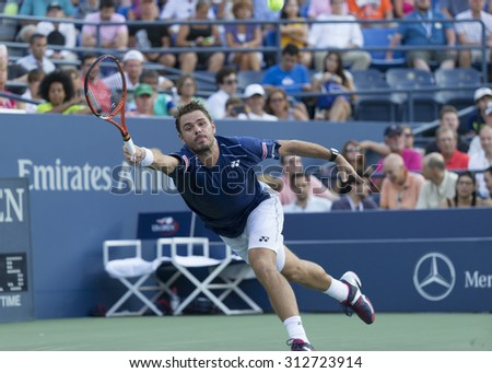 New York, NY - September 1, 2015: Stan Wawrinka of Switzerland returns ball during 1st round match against Albert Ramos-Vinolas of Spain at US Open Championship - stock photo