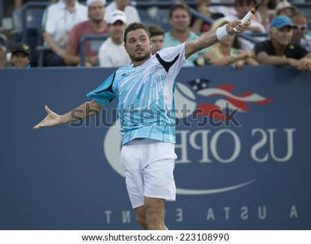 NEW YORK, NY - SEPTEMBER 1, 2014: Stan Wawrinka of Switzerland shows tattoo Ever tried. Ever failed. No matter. Try Again. Fail again. Fail better. by Samuel Beckett at US Open championship in Queens - stock photo