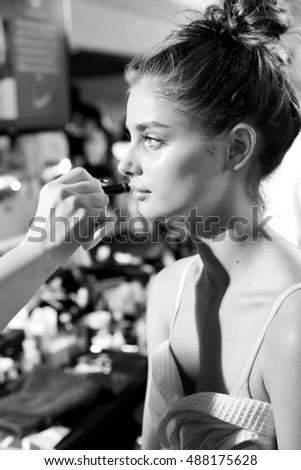 New York, NY - September 09, 2016: Taylor Hill prepares backstage for the Tommy Hilfiger Fall 2016 Fashion Show - Part 2, during New York Fashion Week