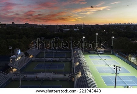 NEW YORK, NY - SEPTEMBER 3, 2014: View of sunset and empty outer courts during night session at US Open championship in Flushing Meadows USTA Tennis Center - stock photo