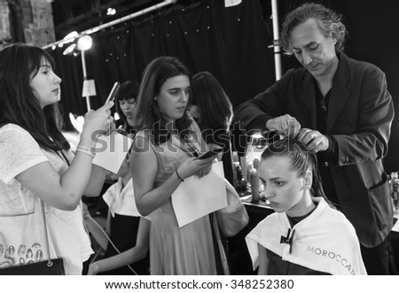 New York, NY - September 12, 2015: Waleska Gorczevski prepares backstage for the Monique Lhuillier Spring 2016 fashion show during New York Fashion Week at The Arc - Skylight Moynihan Station