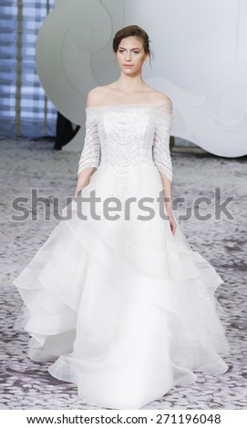 New York, NY, USA - April 17, 2015: A model walks runway for RIVINI Spring 2016 Bridal Collection at The Park Hyatt Hotel during New York Bridal week, Manhattan - stock photo