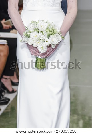 New York, NY, USA - April 16, 2015: A model walks runway for Theia Spring 2016 Bridal Collection at Theia Showroom during New York Bridal week, Manhattan