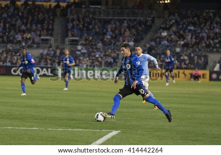 New York, NY USA - April 27, 2016: Ignacio Piatti (10) of Montreal Impact controls the ball during MLS game NYC FC against Montreal Impact at Yankee Stadium - stock photo