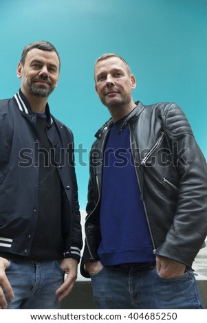 New York, NY USA - April 12, 2016: Michael Elmgreen and Ingar Dragset pose during unveiling Van Gogh's Ear sculpture by Elmgreen & Dragset at Rockefeller Center  - stock photo