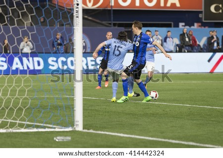 New York, NY USA - April 27, 2016: Thomas McNamara (15 of NYC FC & Wandrille Lefevre (5) of Montreal Impact fight for ball in Montreal penalty box