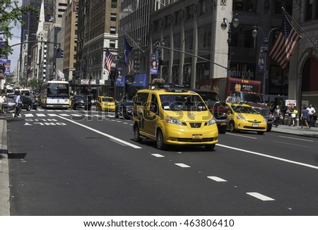 New York, NY USA--Aug 3, 2016 Traffic is busy on Fifth Avenue as cabs, cars and buses head South around lunchtime. Editorial Use Only.