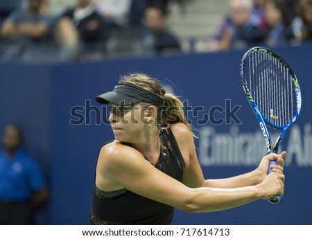 New York, NY USA - August 28, 2017: Maria Sharapova of Russia returns ball during US Open Championships day match against Simona Halep of Romania at Billie Jean King Tennis center