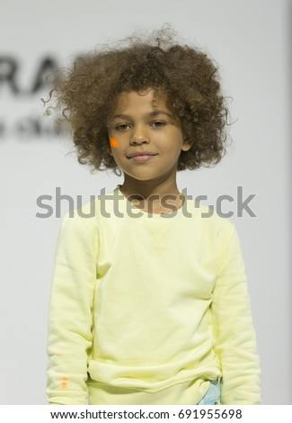 New York, NY USA - August 7, 2017: Young model walks runway for Vingino during petiteParade at children's Club August 2017 edition at Jacob Javits Center