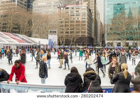 New York, NY, USA - December 28, 2014: People having fun at Bryant Park ice rink. The rink features free admission ice skating, skating shows, special events, and activities. - stock photo