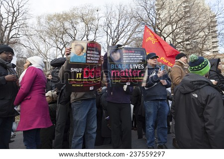 New York, NY USA - December 13, 2014: Protesters march against police brutality and grand jury decision on Eric Garner case on Washington Square